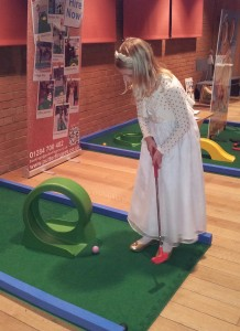 One of the bridesmaids at the show enjoying mini golf