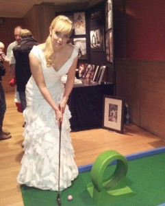 Bride playing mini golf
