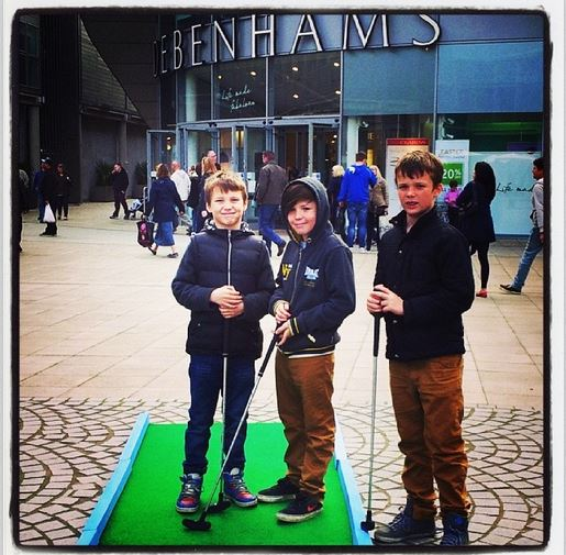 Young lads enjoying a spot of crazy golf