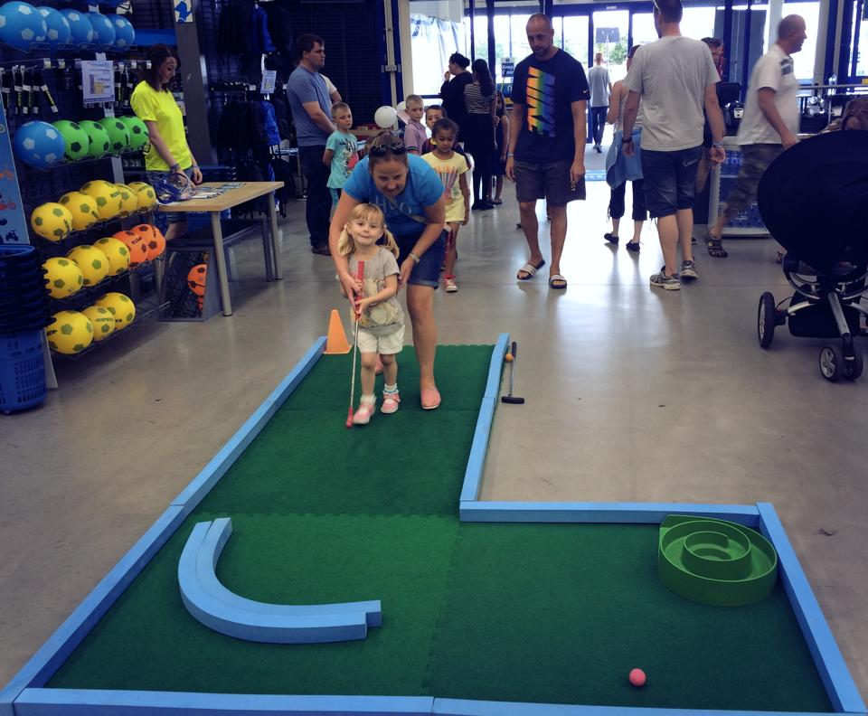 Decathlon Bolton's Family Fun Day with some guests trying out mini golf July 2014