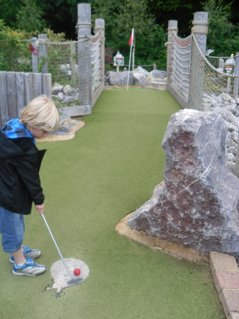 Playing the adventure golf course at Legoland Windsor