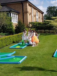 Kids playing crazy golf at wedding