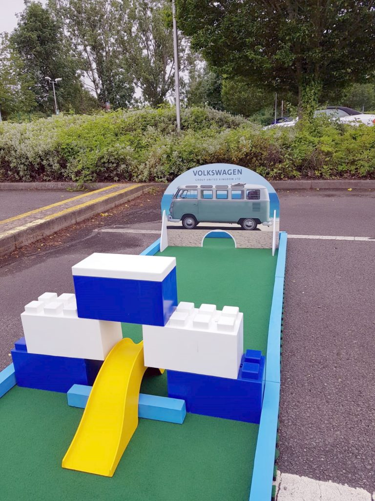 Employees enjoy mini golf at corporate event