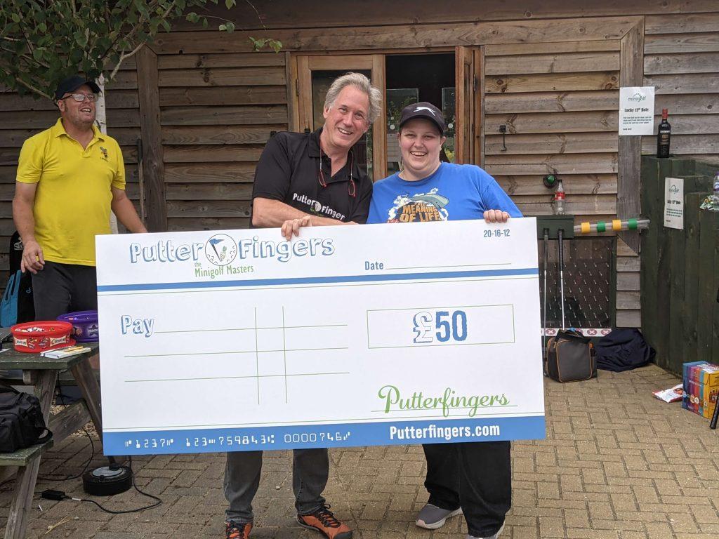 Prize cheque for mini golf tournament winner